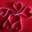 Valentine hearts, White Valentine's paper hearts on red background — Stock Photo