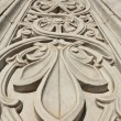 Stock Photo: Marble flower pattern on the wall of the building