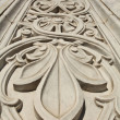 Marble flower pattern on the wall of the building — Stock Photo