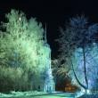 Christmas winter landscape, a church in the city park at night — Stock Photo