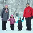 Complete family with children walking in winter — Stock Photo