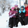 Stock Photo: Complete family with children walking in winter