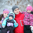 Complete family with children walking in winter — Stock Photo #22168047