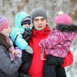 Complete family with children walking in winter — Stock Photo #22168059