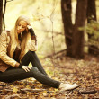 Beautiful young girl in the autumn forest — Stock Photo