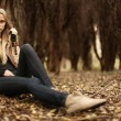 Beautiful young girl in the autumn forest — Stok fotoğraf