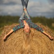 Young beautiful blonde in the hay outdoor - Stock Photo
