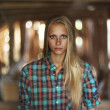 Beautiful mysterious young woman in the attic in a wooden house with ghosts — Stock Photo