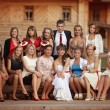 Young bride and groom with bridesmaids. Wedding in a rustic style — Stock Photo