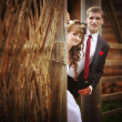 Bride and groom in a village — Stock Photo #22169091
