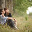Man and woman embracing in nature — Stock Photo