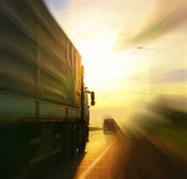 Truck on blurry road — Stock Photo