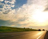 Car on highway, summer sunset — Stock Photo