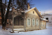 Russian traditional wooden house with wood carving — Stock Photo