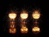 Wine glasses with sparks — Stock Photo