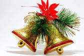 Golden bells with a red bow. isolated on white. — Stock Photo