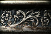 Floral designs, engraving on copper, floral ornament on metal texture — Stock Photo