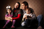 Portrait of a family of four, mom dad daughter and son, with you — Stock Photo