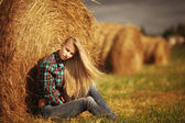 Young beautiful blonde in the hay outdoor — Stock Photo