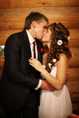 Bride and groom kissing in the village — Stock Photo