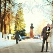 Man and woman walking on the street in winter wedding — Stock Photo