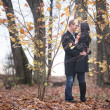 Young lovers man and woman in the autumn forest — Stock Photo