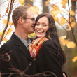 Stock Photo: Young lovers mand womin autumn forest