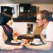 Young lovers man and woman talking in the cafe — Stock Photo