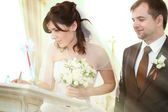 Wedding in Russia, the bride and groom in their wedding clothes in the registry office — Stock Photo