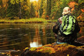 Men, lake and forest — Stock Photo