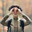 Girl tourist making  binoculars joke — Stock Photo
