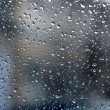 Stock Photo: Raindrops on glass, blurred