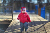 Little cheerful girl 2-3 years, playing on the street — Стоковое фото