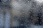 Raindrops on glass, blurred — Stock Photo