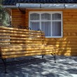 Stock Photo: Bench near small house