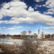 ice drift on the river in russia, the church on the shore — Stock Photo