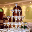 Stock Photo: Pyramid of glasses of wine, champagne