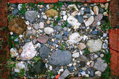 Texture of pebbles, cobbles, stones — Stock Photo