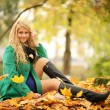 Blond woman in autumn park — Stock Photo