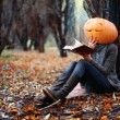 Halloween girl with pumpkin head — Stock Photo #36319013