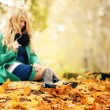 Sad girl autumn leaves in a fuzz — Stock Photo