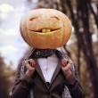 Halloween girl with pumpkin head — Stock Photo