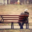Lonely man on the bench autumn — Foto de Stock