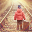Little traveler with a suitcase on the railroad — Stock Photo