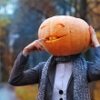 Stock Photo: Halloween girl with pumpkin head