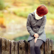 Sad girl in autumn — Stock Photo