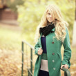 Beautiful happy blond woman in autumn park — Stock Photo