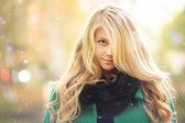 Beautiful blonde in autumn winter coat — Stock Photo