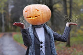 Halloween girl with pumpkin head — Foto Stock
