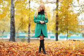 Sad melancholy blond woman in autumn forest — Stock Photo